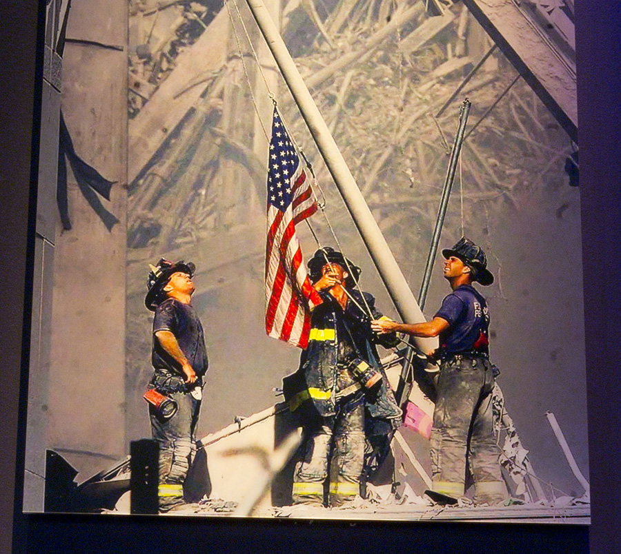 FDNY Three firefighters raise the American flag in the afternoon on the pile of wreckage of the World Trade Center, now Ground Zero. Dan McWilliams, George Johnson, Ladder 157, and Billy Eisengrein, Rescue 2 by Thomas E Franklin. Photo on view in 9/11 Memorial Museum.