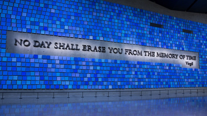 "A large plaque in Memorial Hall reads, ""No day shall erase you from the memory of time."" The quote from Virgil's epic poem The Aeneid is surrounded by 2,983 individual blue tiles that comprise ""Trying to Remember the Color of the Sky on That September Morning,"" an installation by Spencer Finch. Every square is a unique shade of blue, reflecting the artist's attempt to remember the color of the sky on the morning of 9/11 and commemorating the victims of September 11, 2001 and February 26, 1993."