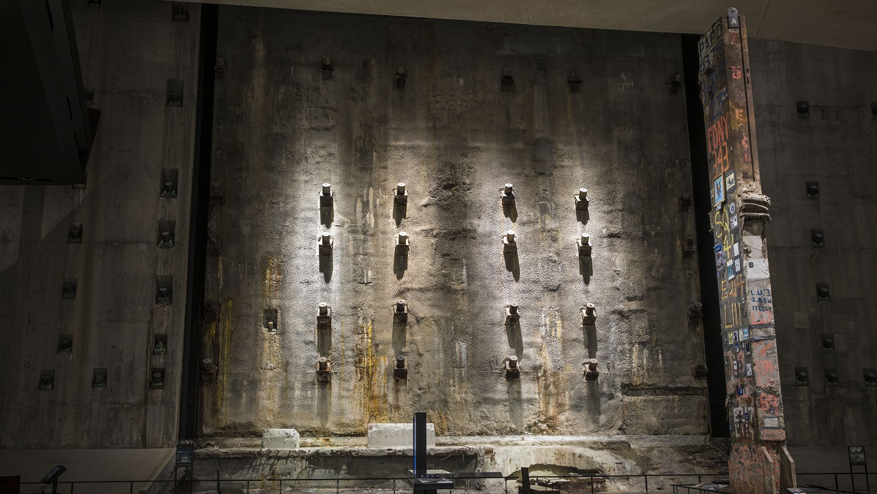The slurry wall illuminated in the 9/11 Memorial Museum.