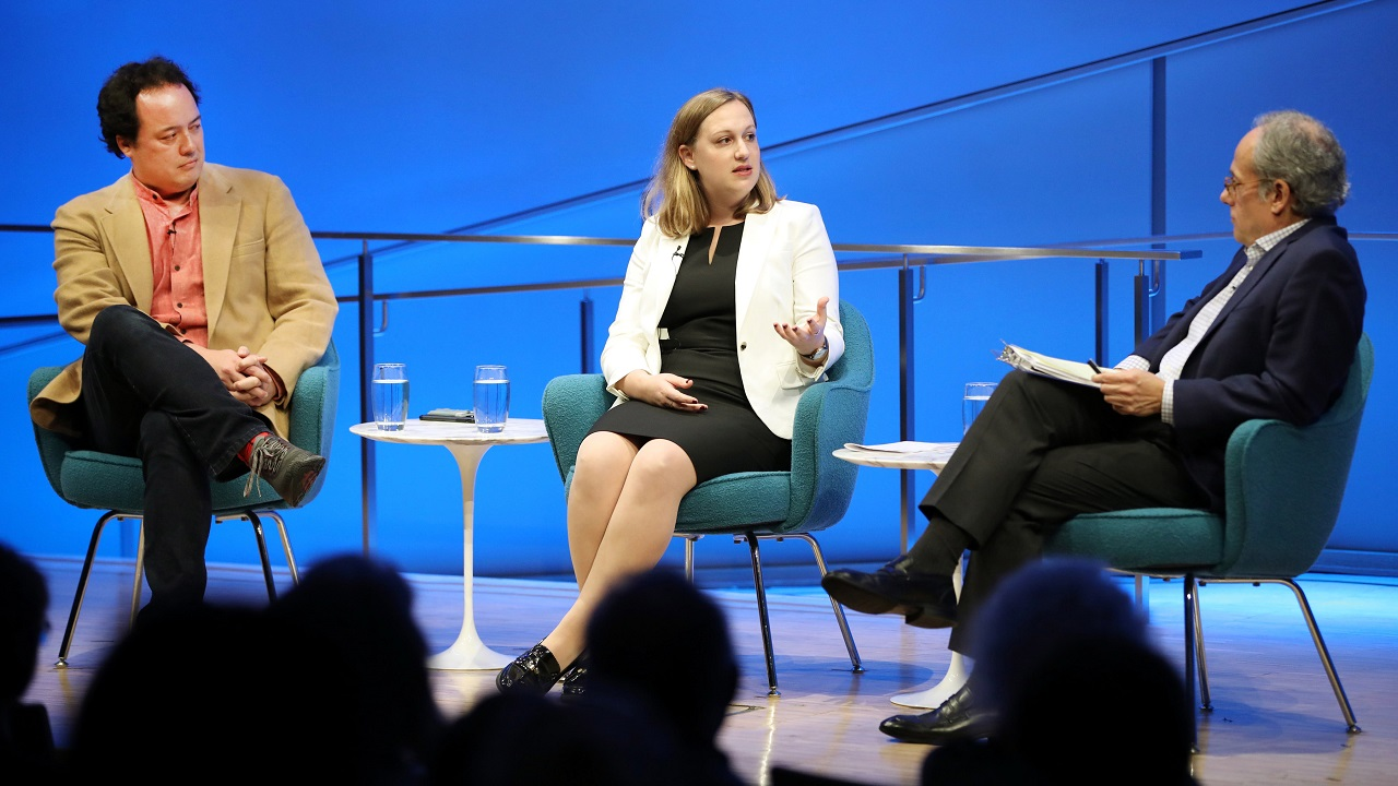 Devorah Margolin of George Washington University gestures as she speaks to Clifford Chanin, the executive vice president and deputy director for museum programs, onstage during a public program at the Museum auditorium. Graeme Wood of The Atlantic is seated next to her.