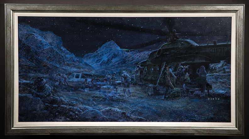 Monochromatic painting in shades of blue, green, and black depicting soldiers carrying supplies from a helicopter to a truck on a rocky terrain at night.