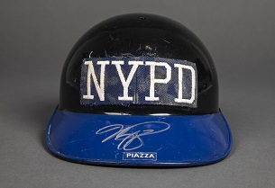 A black baseball helmet with NYPD lettering worn and a blue bill was worn by New York Mets player Mike Piazza after 9/11 and was donated to the 9/11 Memorial Museum's collection.
