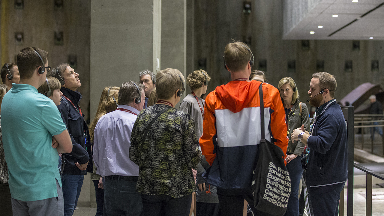 Visitors listen as a tour guide speaks in the 9/11 Memorial Museum.