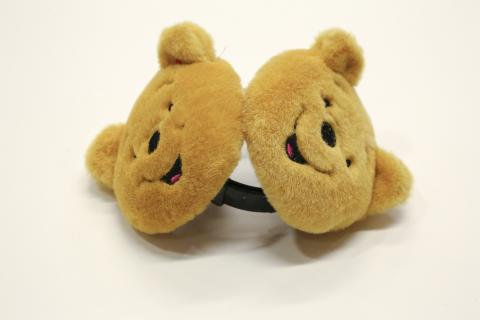 Winnie the Pooh earmuffs belonging to Asia S. Cottom are displayed on a white surface.
