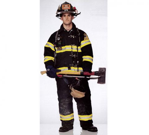 Firefighter Jason Cascone holds an axe as he poses in his bunker gear for the Faces of Ground Zero.