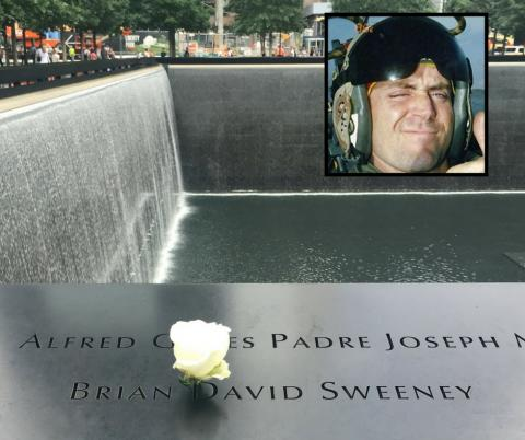 A white rose has been placed at the name of Brian David Sweeney. An inset photo of Sweeney is to the right of the image.