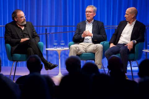 Mandy Patinkin, Alex Gansa, and Howard Gordon speak onstage at a public program at the 9/11 Memorial Museum's Auditorium.