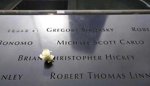 A white rose has been placed at the name of Brian Christopher Hickey at the 9/11 Memorial.