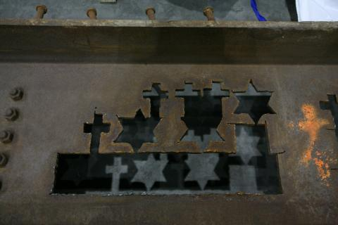 Crosses and Stars of David are seen forged in World Trade Center steel.