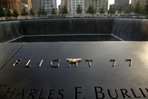 Pilot wings have been placed at the section of the 9/11 Memorial paying tribute to the victims of Flight 77. The reflecting pool is in the background.