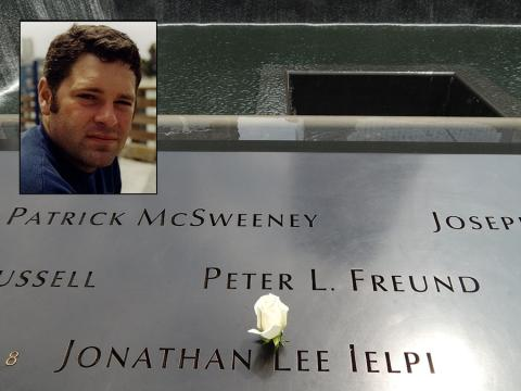 A rose has been placed on the name of FDNY firefighter Jonathan Ielpi at the 9/11 Memorial. An inset photo shows Ielpi smiling for a photo.