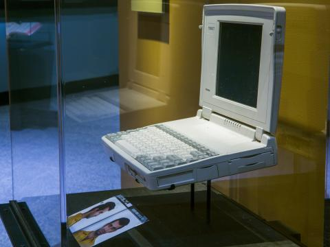 A laptop computer belonging to terrorist Ramzi Yousef is seen in a display case at the Museum's Historical Exhibition. The laptop is an older model, dating back to at least the early 1990s. An image of Yousef is displayed below it.