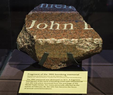 A fragment of the destroyed granite memorial to the victims of the 1993 World Trade Center bombing is on display at the Museum. The name John can be made out on the chunk of red, white, and black granite.