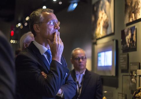 NATO Secretary General Jens Stoltenberg puts his hand to his mouth as he looks at an installation at the 9/11 Memorial Museum.
