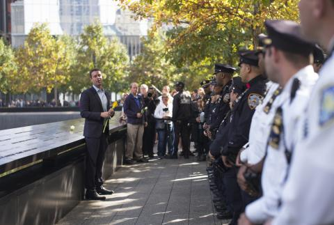 9/11 Memorial President Joe Daniels addresses dozens of NYPD officers beside a reflecting pool on Memorial plaza.