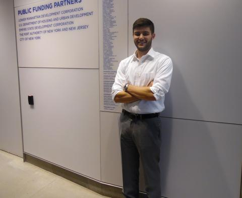 John Andelfinger, a 9/11 Memorial events intern, poses for a photo in a hallway of the 9/11 Memorial Museum.