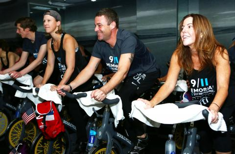 9/11 Memorial President Joe Daniels uses a stationary bike along with other people participating in the third annual SoulCycle Ride to Remember.