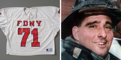 The red and white FDNY football jersey of firefighter Durrell 'Bronko' Pearsall is displayed on a gray surface at the Museum. An adjacent image shows Pearsall smiling in his bunker gear.