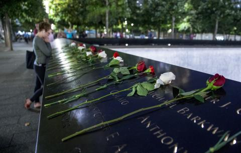 Red and white roses have been left on the bronze parapets at the 9/11 Memorial.