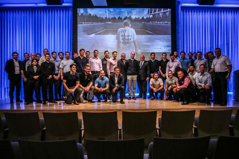 The New York Rangers pose for a photo onstage at the 9/11 Memorial Museum's Auditorium.
