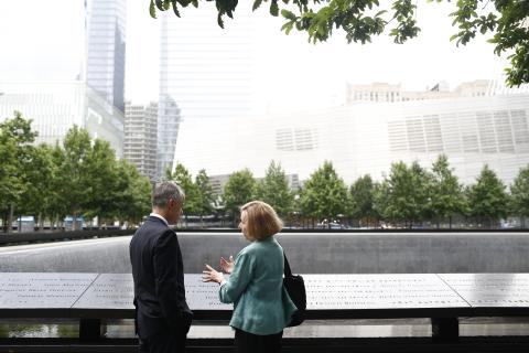 FBI Deputy Director Andrew McCabe and 9/11 Memorial Museum Director Alice Greenwald speak beside a reflecting pool at the 9/11 Memorial.