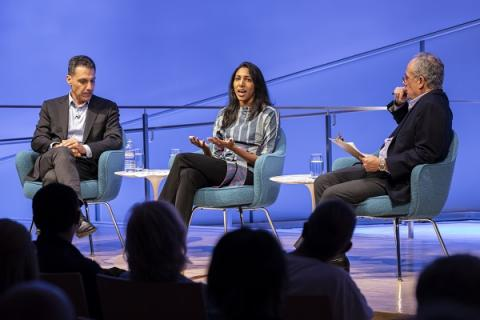 Hany Farid and Vidhya Ramalingam speak onstage during a public program at the Museum auditorium.