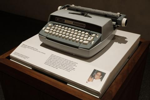 The gray and white typewriter belonging to Yudhvir S. Jain is displayed at the 9/11 Memorial Museum.