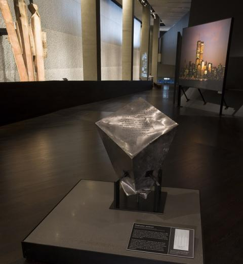 A stainless-steel pedestal that commemorated the dedication of the World Trade Center site in 1973 is displayed at the 9/11 Memorial Museum. The pedestal survived the 9/11 attacks.