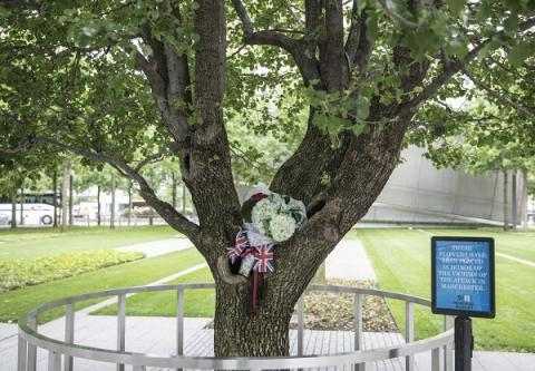 A tribute made up of flowers and British flags have been placed at the Survivor Tree following terrorist attacks in the United Kingdom.
