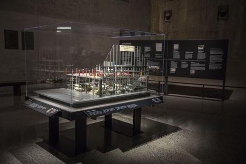 A model of the World Trade Center parking garage is shown encased in display glass on a table at the Museum.