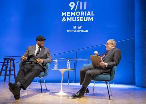 Former New York Yankees player Bernie Williams speaks to Cliff Chanin, the 9/11 Memorial Museum's executive vice president and deputy director for museum programs, while onstage at the auditorium.