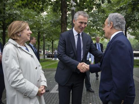 NATO Secretary General Jens Stoltenberg shakes hands with Clifford Chanini, the executive vice president and deputy director for museum programs. 9/11 Memorial President and CEO Alice Greenwald stands beside them.