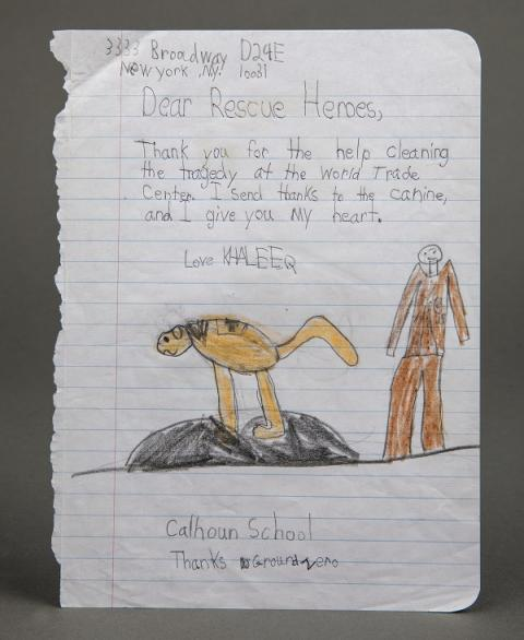 A child's drawing thanks the heroes of 9/11 rescue and recovery efforts. The drawing has been sketched on ruled paper and shows a man and a dog and includes a note signed by a child named Khaleeq.