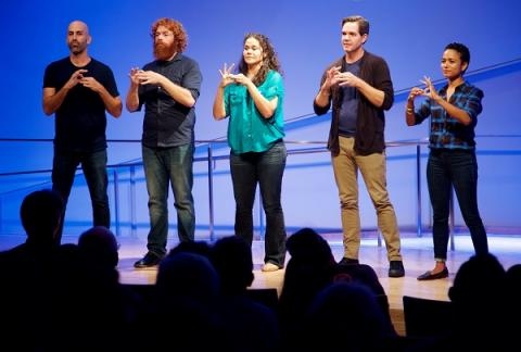 Three men and two women gesture onstage during the ASL Slam at the Museum auditorium.