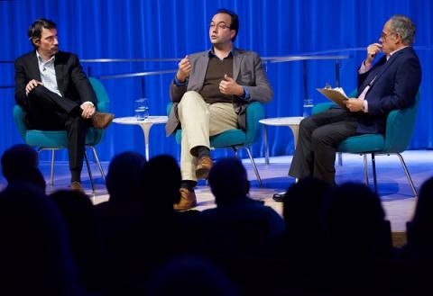 Documentarians Gédéon and Jules Naudet speak onstage with Clifford Chanin, the 9/11 Memorial Museum's executive vice president and deputy director for museum programs, during a public program at the Museum auditorium.
