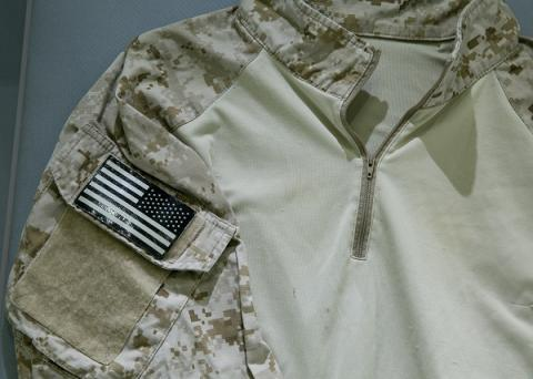 A camouflage shirt worn by a U.S. Navy seal team member who was present for Osama bin Laden's killing is displayed at the 9/11 Memorial Museum.