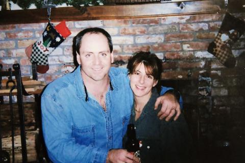 Brian Sweeney and Julie Sweeney Roth smile in an old photo.