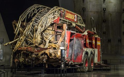 FDNY Ladder 3's truck, partially crushed, sits on display in the 9/11 Memorial Museum.