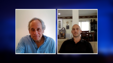 A screenshot of two men engaged in a video chat.