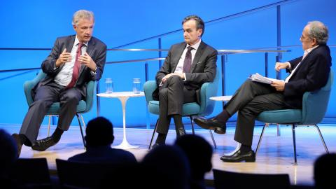 The silhouettes of audience members are visible in the foreground as Peter Ammon, former Ambassador of Germany to the U.S., speaks onstage during a public program in the Museum auditorium. He is seated next to Gérard Araud, former Ambassador of France to the U.S., and Clifford Chanin, the executive vice president and deputy director for museum programs.