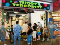 "Oil painting of a boardwalk shooting stand from Seaside Heights, NJ called ""Shoot the Terrorist,"" which featured a large photo of binLaden, beer funnels and neon paint ball splatters during the summer of 2009."