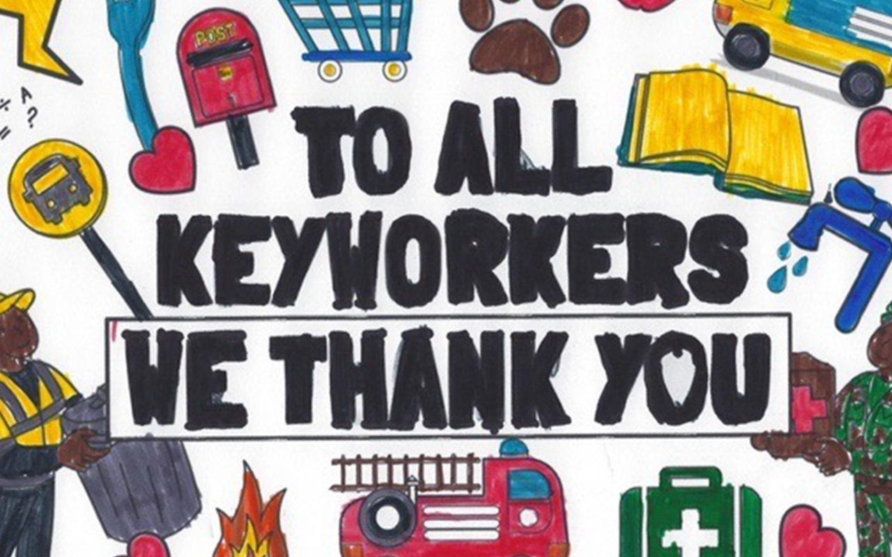 "A hand-drawn poster reads ""To All Keyworkers, We Thank You.""   The slogan is surrounded by drawings of a sanitation worker, fire truck, a shopping cart,  medical instruments and other tools of frontline workers."