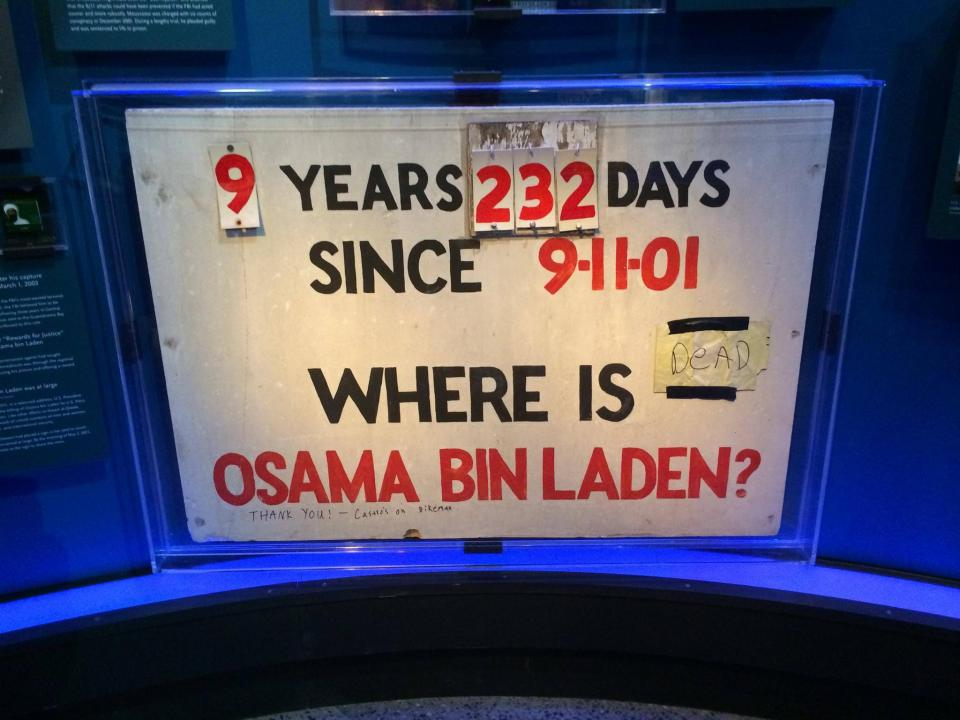 "A homemade sign displayed at the Museum counts the number of days since 9/11. The sign also reads, ""Where is Osama bin Laden?"" A handwritten not taped next to the question reads, ""Dead."""