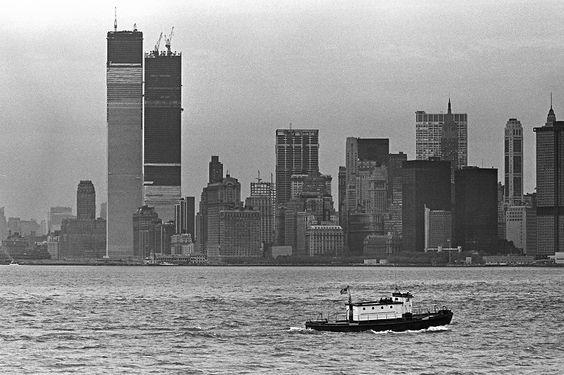 A photo from New York Harbor shows the lower Manhattan skyline and the World Trade Center under construction in 1970.