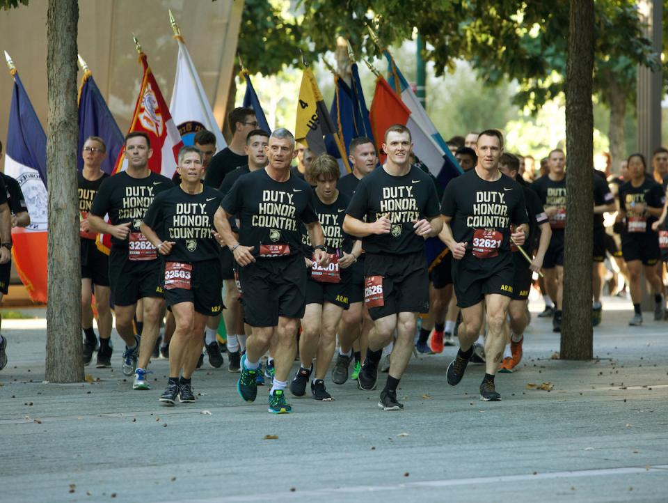 West Point Cadets run in formation at the 9/11 Memorial.