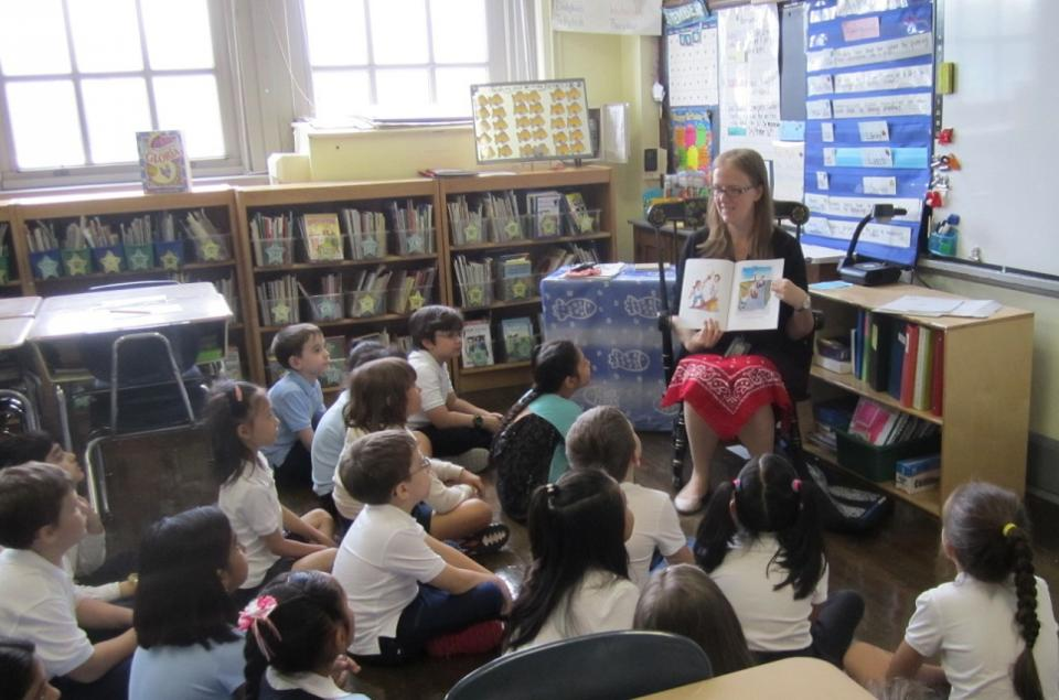 "9/11 Museum educator Jennifer Lagasse reads ""The Man in the Red Bandana"" to students at PS 199."
