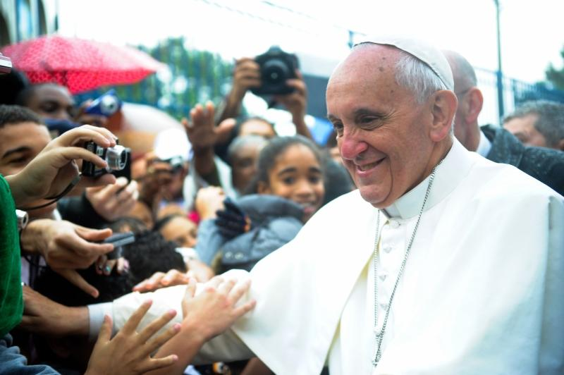 Pope Francis greets visitors in Varginha, Brazil.