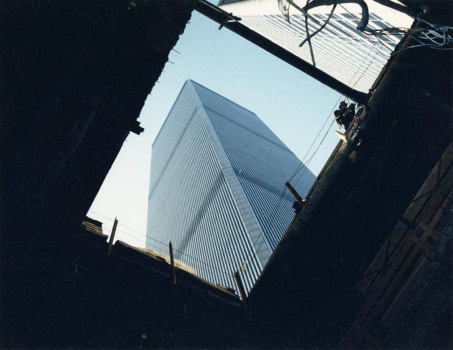 One of the Twin Towers rises into the sky in a photograph taken from the bomb crater created by the 1993 World Trade Center bombing.