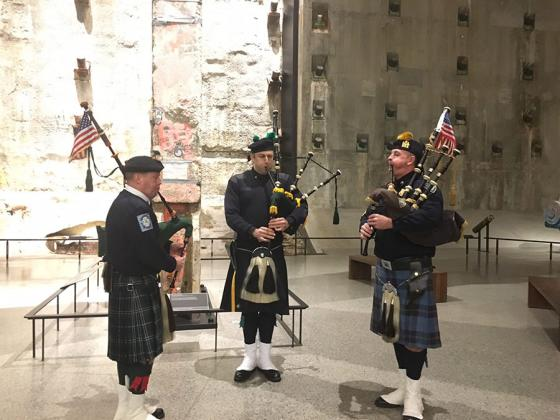 FDNY officer Bob King, NYPD officer Eamon Nugent and PAPD officer Brian Ahern wear kilts as they take part in the weekly bagpipe tribute in Foundation Hall.