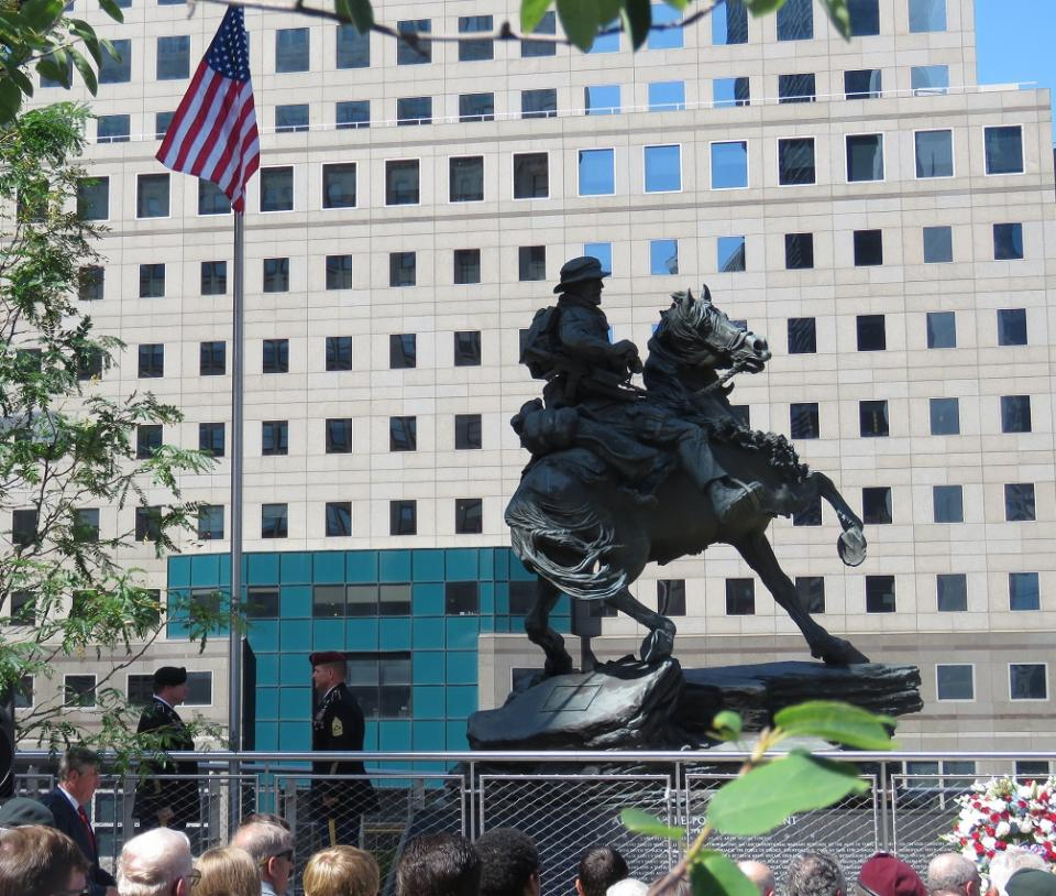 "The ""Horse Soldier"" statue towers over visitors during its dedication ceremony in Liberty Park."